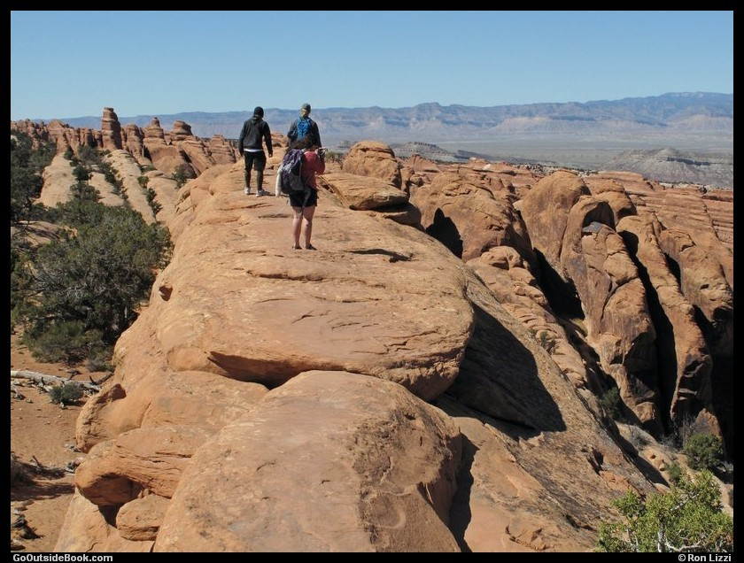 Hikers on the Devils Garden Trail - Arches National Park